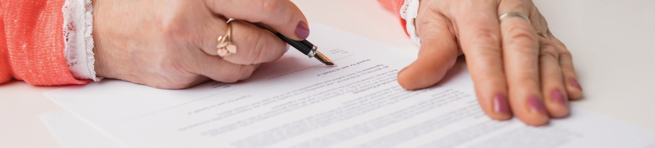 a woman's hands filling out a healthcare related form