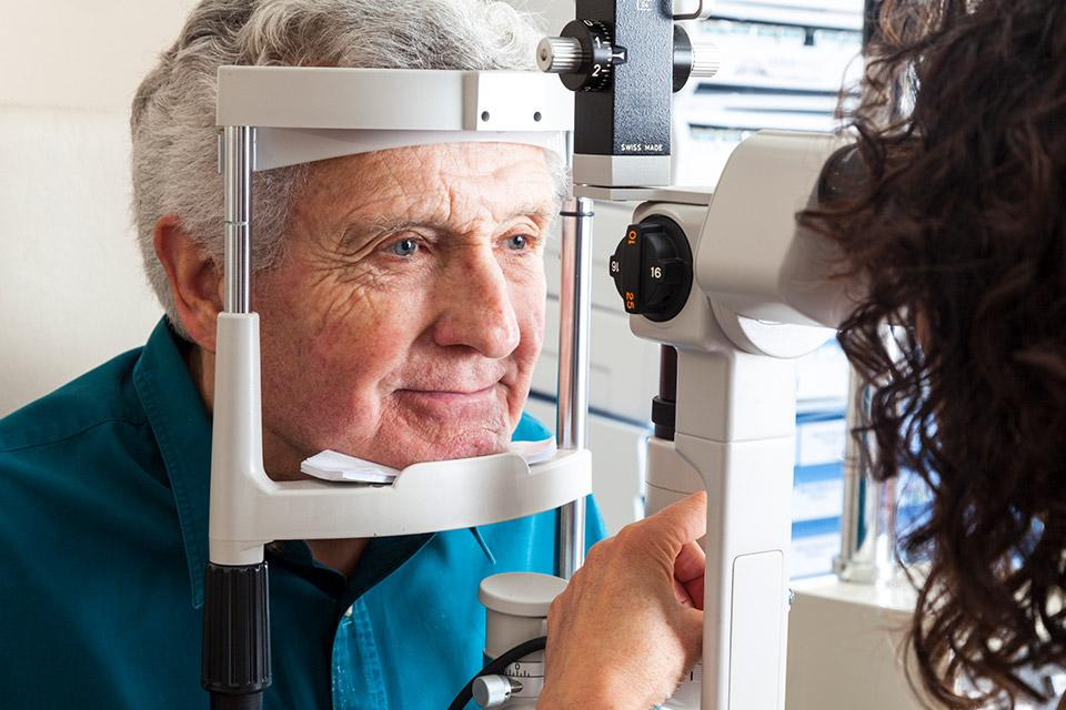 Older man at an eye exam