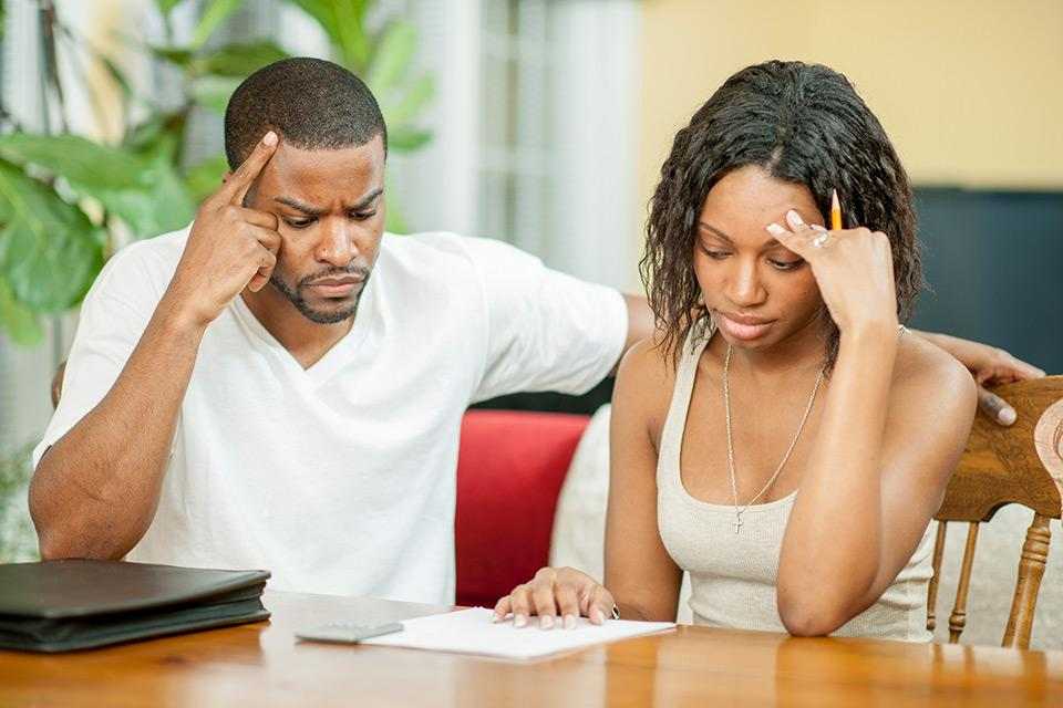 Man and woman stressing over bills